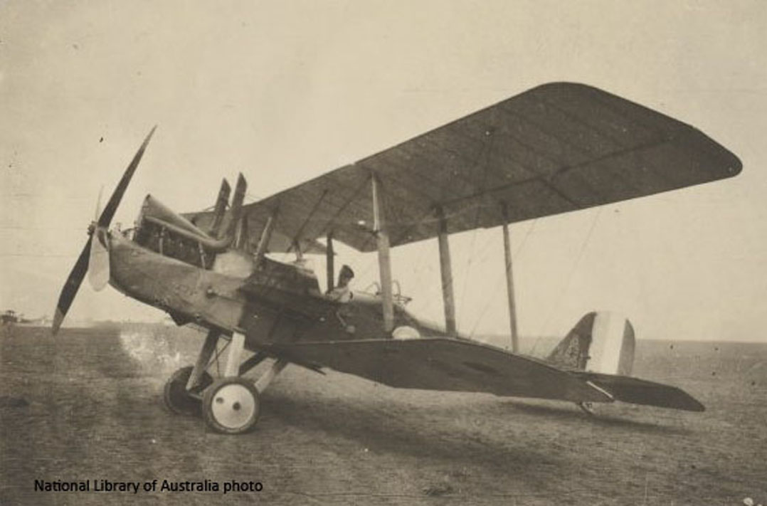 Pilot_of_3_Squadron_Australian_Flying_Corps_seated_in_the_cockpit_of_a_Royal_Aircraft_Factory_RE8_A_3641_biplane_France_1917_NLA